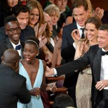 Lupita celebrates as her win for best supporting actress is announced at 86th Academy Awards ceremony.