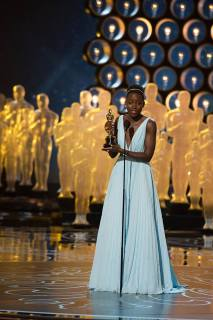 Lupita accepts the Best Performance by an Actress in a Supporting Role award for 12 Years a Slave onstage during the Oscars on March 2, 2014. Photo - ©A.M.P.A.S.