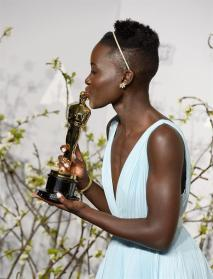 Lupita kisses her award which she won for best supporting actress at 86th Academy Awards ceremony.