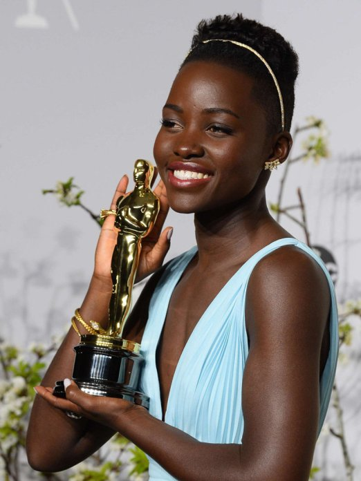 Lupita poses with her award for best supporting actress at the 86th Academy Awards ceremony.