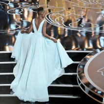 Lupita walks onstage to accept her award for Best Performance by an Actress in a Supporting Role award for 12 Years a Slave onstage during the Oscars on March 2, 2014.