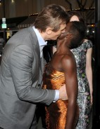 "Lupita Nyong'o with Liam Neeson at the premiere of their film ""Non-Stop"" on February 24, 2014."