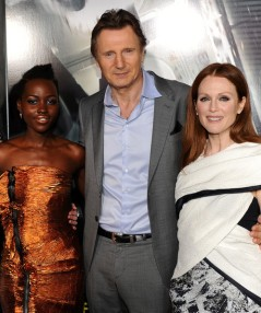 "Lupita Nyong'o with stars of ""Non-Stop"" actors Liam Neeson and Julianne Moore attend the premiere of their film at Regency Village and Bruin Theatres - Westwood, CA."