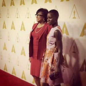 Lupita Nyong'o with the president of The Academy of Motion Picture Arts and Sciences/ The Oscars Cheryl Boone Isaacs at the Oscars nominees luncheon this afternoon.