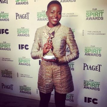 Lupita Nyong'o poses with her Best Supporting Female award for 12 Years a Slave.