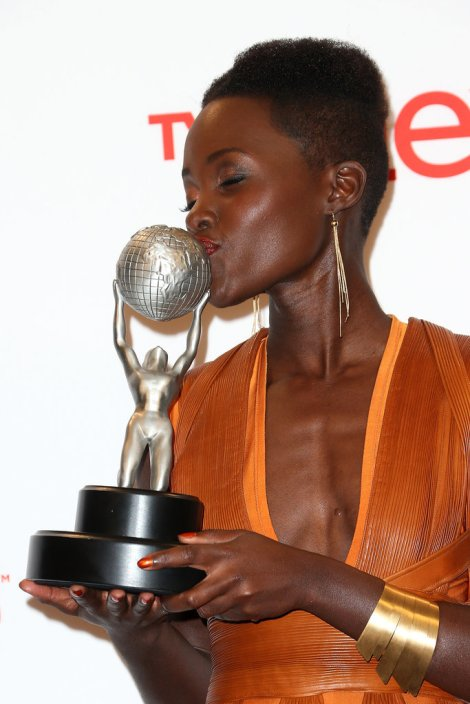 Lupita Nyong'o poses with her Outstanding Supporting Actress in a Motion Picture award for 12 Years a Slave at the 45th NAACP Image Awards.