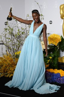 Lupita poses in the press room with the award for best actress in a supporting role for 12 Years a Slave during the Oscars on Sunday, March 2, 2014